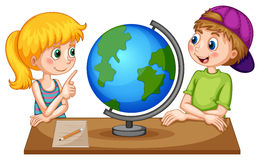 Children looking at globe on the table Stock Photography