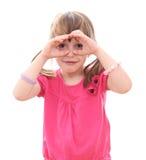 Children looking through imaginary binoculars Royalty Free Stock Image