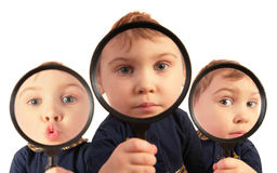 Children looking through magnifiers collage. On white Royalty Free Stock Photography