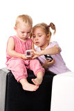 Children looking into the mobile phone Stock Images
