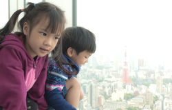 Children is looking out to Tokyo City. Japanese Children is looking out to Tokyo City stock images