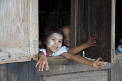 Children looking out the window of school. Burma Stock Photo