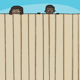 Children Looking Over Fence. Curious boy and girl looking over top of fence Royalty Free Stock Photos