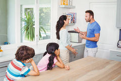 Children looking at parents Stock Photos