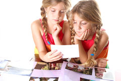 Children looking at photos tog. Shot of children looking at photos together Royalty Free Stock Images