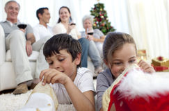 Children looking for presents in Christmas boots Stock Photography