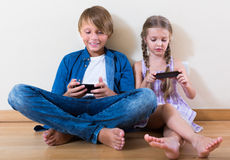 Children looking at screen of smartphones Stock Images