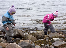Children looking for treasure Royalty Free Stock Photos