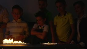 Children looks at fire dancing to the beat of music. Children makes experiment with Ruben`s tube. The fire is dancing to the beat of music in flame tube stock footage