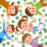 Children lying in clover with heads together Stock Photography