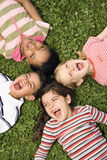 Children Lying in Clover Screaming royalty free stock photo