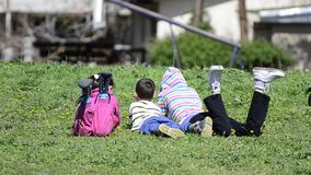 Children Lying On A Meadow Royalty Free Stock Photos