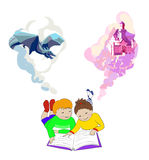 Children lying and reading book. Kids imagination. Children reading a fairytale book. Kids imagination concept. Girl and boy lying on floor. International Royalty Free Stock Photos