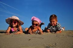 Children lying on the sand Stock Photography