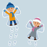 Children lying on snow as snow angels. New Year holidays Stock Images