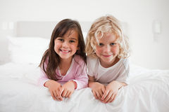 Children lying on their bellies Stock Photo
