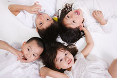 Children lying together Royalty Free Stock Photos