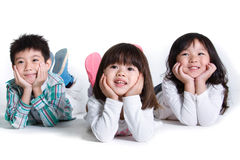 Children lying together Stock Photos