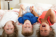 Children Lying Upside Down Bed Royalty Free Stock Photos