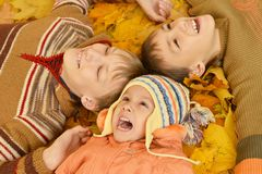 Children lying on yellow Stock Photos