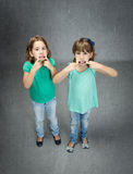 Children made tongue with finger Royalty Free Stock Photography