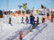 Children on a magic carpet. Ski school in Alps, Austria, Zams on. Children on a magic carpet learn to ski. Ski school. Ski resort in Alps, Austria, Zams on 22 royalty free stock photo