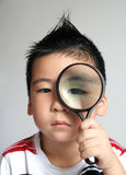 Children with magnifier Stock Photos