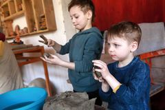 Children make clay crafts. In the workshop royalty free stock photos