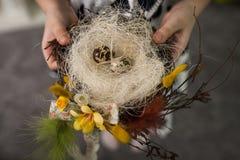 Children make a nest for birds, nest for birds. Children make a nest for birds, bird eggs stock images
