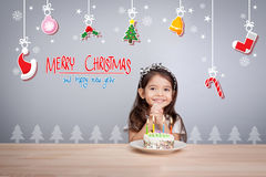 Children make a wish at new year party with cake and candle.  Royalty Free Stock Image