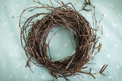 Wreath of branches, nest for birds. Children make a Wreath of branches, nest for birds Stock Photo