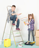 Children makes repairs at home Stock Images