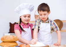 Children making bread Royalty Free Stock Photos