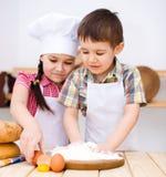 Children making bread stock images