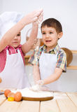 Children making bread Royalty Free Stock Photo