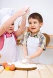 Children making bread royalty free stock photo