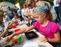 Children making cakes during Apple Feast Day Royalty Free Stock Photos