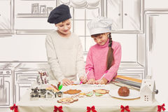 Children making christmas cookies Royalty Free Stock Photos