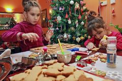 Children making cookies Royalty Free Stock Image