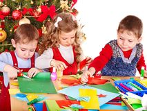 Children  making decoration for Christmas. Royalty Free Stock Image