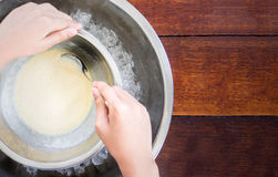 Children making home made ice cream with iced bowl. Stock Images