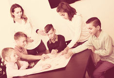 Children making move on pre-marked surface of board game Royalty Free Stock Photography