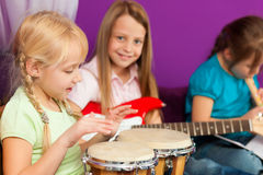 Children making music Stock Image