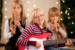 Children making music for Christmas royalty free stock photography