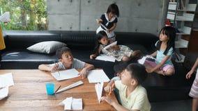 Children making paper airplanes