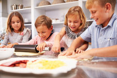 Children making pizza together Royalty Free Stock Photos