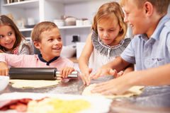 Children making pizza together Stock Images