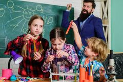 Children making science experiments. Education. chemistry lab. happy children teacher. back to school. doing experiments stock image