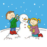 Children making a snowman Stock Image