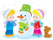 Children making a snowman Stock Photo